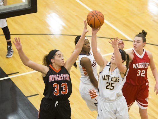 Red Lion's Courtney Dimoff (25) and Northeastern's Jordyn Kloster (33) earned spots on the Class AAAA all-state team.