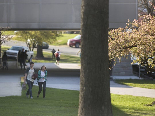 People leave the York Suburban High School campus after
