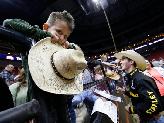 Jess Lockwood, right, and other bull riders will compete Friday through Sunday at JQH Arena during the Professional Bull Riders' Unleash the Beast PFIWestern.com Invitational.