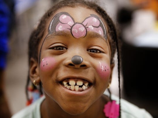 Alexis Allen-Bentley, 6, has her face painted like Minnie Mouse during an open house for the new Finish Line Boys & Girls Club, opening at 38th Street and Post Road. The $4.5M, 22,000-square-foot facility, made possible in part by a major gift of $1.25M from Finish Line, will serve Far Eastside youth ages 5-18.