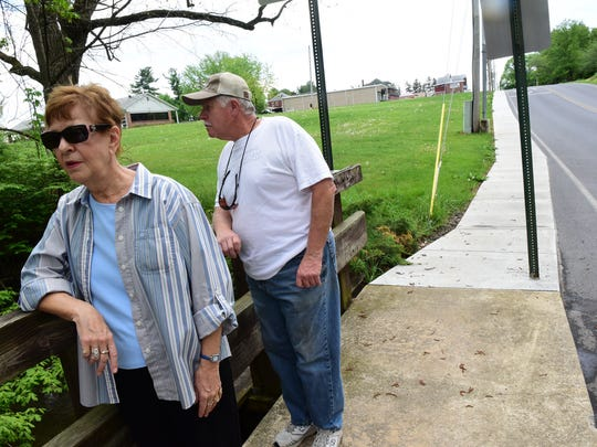 In this file photo, Steven and Evelyn Gray relax at the bridge near their property Monday, May 2, 2016 on Limekiln Drive. The Borough of Chambersburg requires sidewalks on both sides of the street in that area; however, the Grays and other neighbors think there should be an exemption from the rule, because of safety concerns.