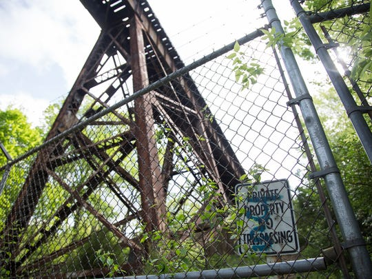 A locked fence and no trespassing sign warns people from entering the Pope Lick train trestle where a 26-year-old Ohio tourist recently died after being struck by a train, falling more than 80 feet to the ground below. May 2, 2016.