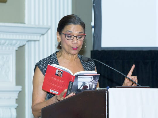 """Actress Sonia Manzano reads an excerpt from her book, """"Becoming Maria: Love and Chaos in the South Bronx,"""" during the 2016 SpiriTrust Lutheran Cornerstone Dinner."""