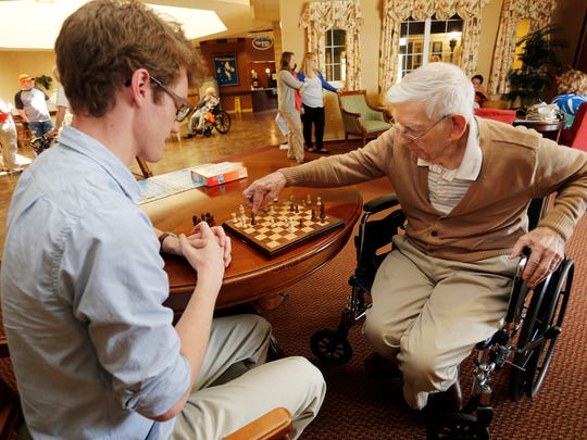 Bill Nangle, 89, right, executes a move as he play