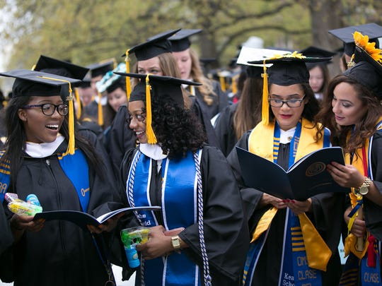 """Graduating seniors sing """"The Genesee,"""" the University's Alma Mater, at the University of Rochester's Commencement ceremony in Rochester on May 15, 2016."""