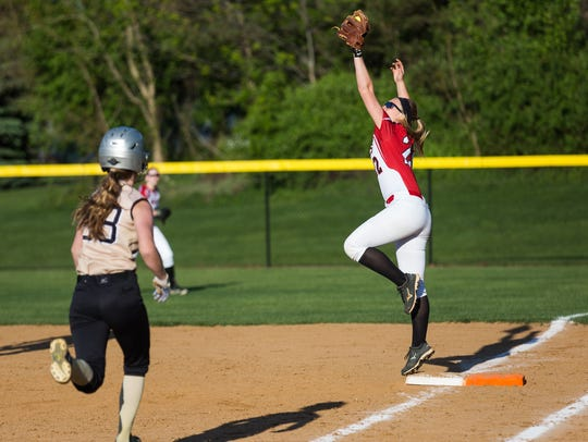 Susquehannock's Ally Kerr (22) catches the ball on
