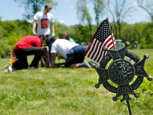 LAF Students give cemetery new life