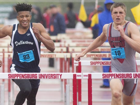 Dallastown's Justin Atwood, left, and Bermudian Springs' Trevor Grim compete in the 110-meter hurdles Saturday at the District 3 Class AAA track and field championships at Shippensburg University.