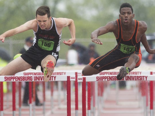 Schuylkill Valley's Brett Koch, left, and Hanover's Deandre Kerr compete in the 110-meter hurdles at the District 3 Class AA track and field championships Saturday at Shippensburg University. Camp Hill's Zack Kuntz won the event. Koch placed second and Kerr placed third.