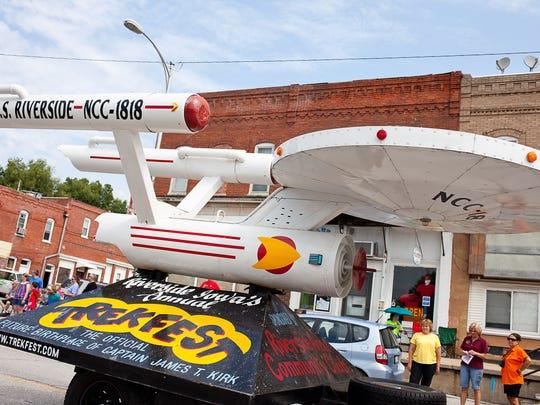 The USS Enterprise float rolls through downtown Riverside in the annual Trek Fest parade Saturday, June 30, 2012.