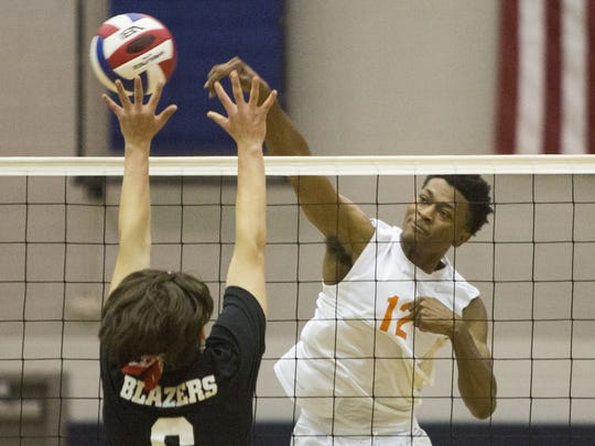 Northeastern's Jeff Reynolds spikes the ball. Northeastern defeated Lancaster Mennonite, 3-0, in a District 3 Class AA boys' volleyball semifinal Wednesday at Dallastown Area High School.