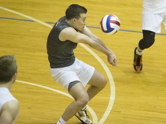 Northeastern's Chris Lee bumps the ball. Northeastern defeated Lancaster Mennonite, 3-0, in a District 3 Class AA boys' volleyball semifinal Wednesday at Dallastown Area High School.