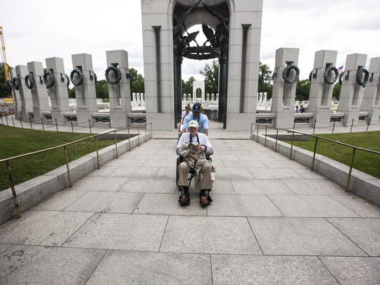 A veteran visits the WWII Memorial in Washington D.C. in 2013.