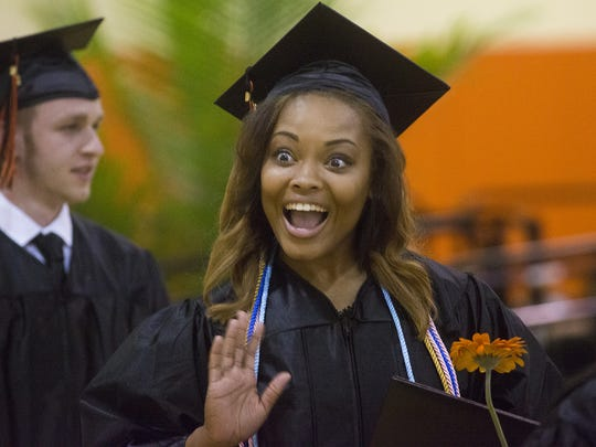 Taija Brown reacts after spotting her mother in the crowd. Central York High School held its commencement ceremony in the school's gymnasium in Springettsbury on Friday night.