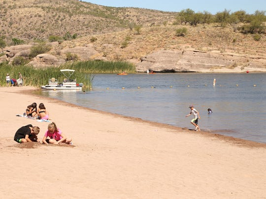Kids enjoy a day at Boulder Beach, a sandy plot on the shore of Patagonia Lake.