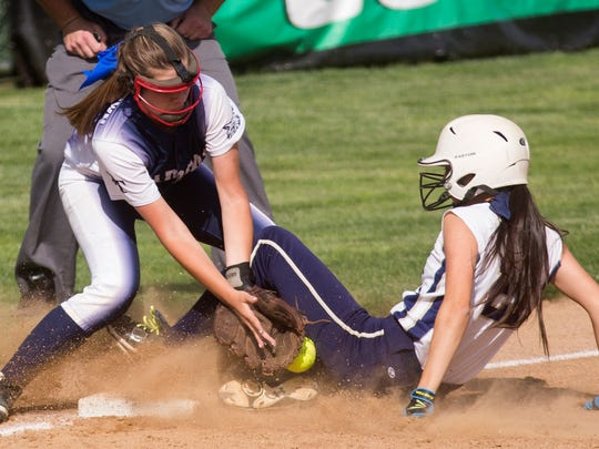 Dallastown's Kelsie Merriman is unable to make the tag as Penn Manor's Victoria Malpica slides safely into third base. Malpica eventually scored in the inning -- the lone run of the contest -- in Penn Manor's 1-0 victory over the Wildcats.