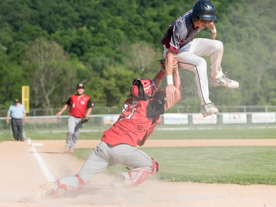 Meyersdale's catcher Max Caton tags out Cooper Grove from Southern Fulton as Grove tries to make it to home plate   during the District 5 Championship on Wednesday, June 1, 2015 in Everett, Pa. Southern Fulton defeated Meyersdale 4-1.