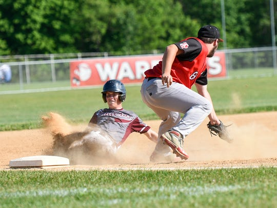 Southern Fulton's Cooper Grove, left, slides into third base during the District 5 Class A championship. The Indians face Greensburg Central Catholic in the first round of states.