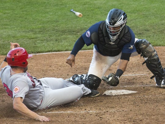 York catcher Isaias Tejeda tags out Lancaster's Josh Whitaker as he slides into home plate. The York Revolution defeat the Lancaster Barnstormers 5-3 at PeoplesBank Park in York, Friday, June 3, 2016.