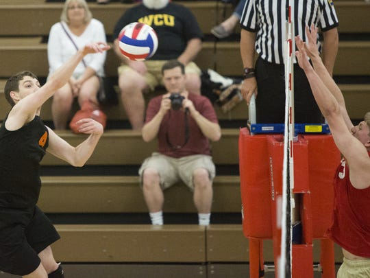 York Suburban's Ian Firestone hits the ball over the net. York Suburban defeats Holy Redeemer 3-2 in the quarterfinals of the PIAA Class AA boys' volleyball state championships at Exeter Township Senior High School, Saturday, June 4, 2016.