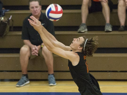 York Suburban's Nick Bowman saves the ball. York Suburban defeats Holy Redeemer 3-2 in the quarterfinals of the PIAA Class AA boys' volleyball state championships at Exeter Township Senior High School, Saturday, June 4, 2016.
