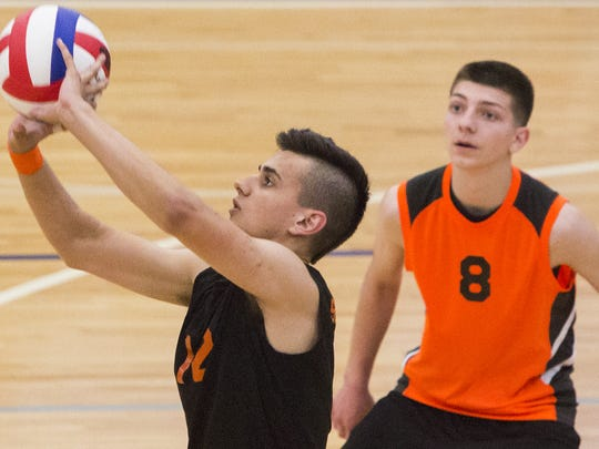 York Suburban's Josh Upadhyay sets the ball as Gavin Dean looks on. York Suburban defeats Holy Redeemer 3-2 in the quarterfinals of the PIAA Class AA boys' volleyball state championships at Exeter Township Senior High School, Saturday, June 4, 2016.