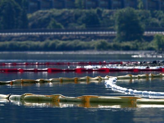 oil containment booms in river