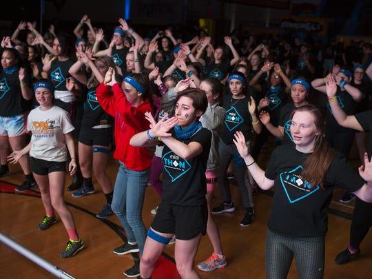 Students dance during the mini-THON at York Suburban