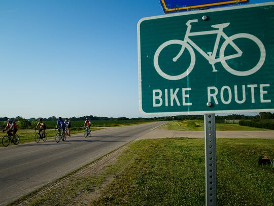 Members of the RAGBRAI preride team roll out of Ottumwa