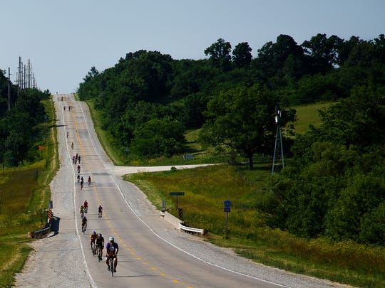 Members of the RAGBRAI preride team roll along the