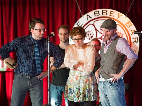 From left to right, Andy Shaw, Josh Miller, Liz Curtis and Toby Bradbury of The Oxymorons Comedy Troupe perform at The Abbey Bar inside Appalachian Brewing Company.
