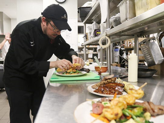 Executive chef Roger Payne prepares food at PJ's - SentryWorld located at 601 Michigan Avenue North in Stevens Point, Thursday, June 9, 2016.