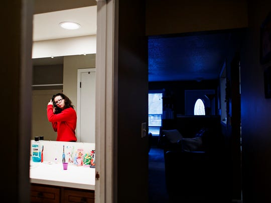 Alexis Myers, 15, brushes her hair before going to school on Friday, March 4, 2016 in Manson, Ia.