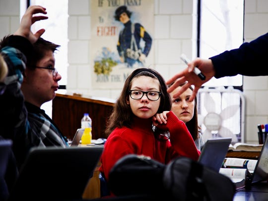 Alexis Myers, 15, listens during class at Manson Northwest Webster school on Friday, March 04, 2016 in Manson, Ia. Her hearing and eyesight often force her to sit in the front of the classroom so she can see what is on the board.
