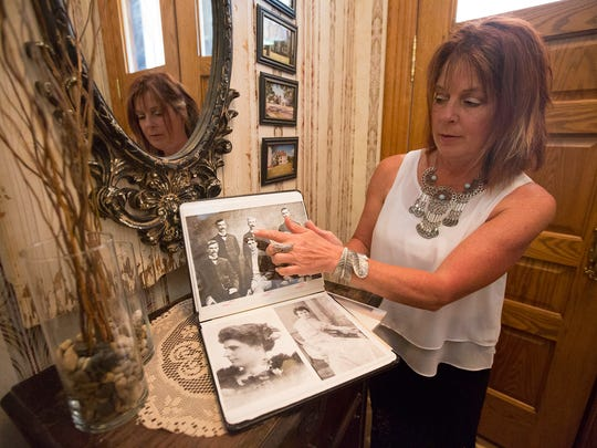 Owner of Le Chateau Bed and Breakfast Faye Collier shows a book she compiled on the history of the house in Wisconsin Rapids, Tuesday, June 28, 2016.