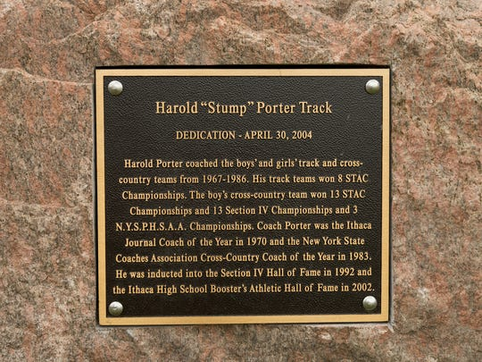 "The plaque honoring Harold ""Stump"" Porter is mounted to a 3-ton granite boulder next to the first turn of the Ithaca High School track."