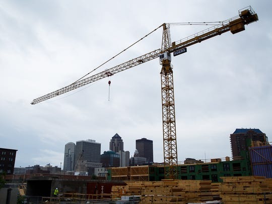 The Roers tower crane works at the construction site at 2nd and Market streets in downtown Des Moines on Thursday, June 30, 2016.