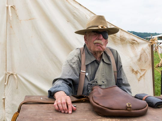 "John Kürlander, of Appamattox, Va., a retired U.S. Marine Corps officer, sits in front of a tent while taking part in the 153rd Battle of Gettysburg re-enactment on June 1, 2016 in Gettysburg. ""History happens,"" said Kürlander, ""some is good, some is bad."" - Harrison Jones for the Evening Sun"