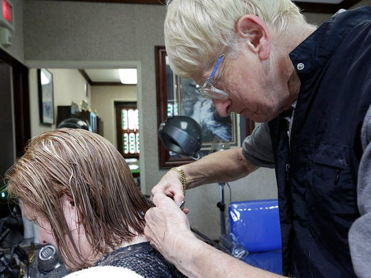 Don Abler cuts the hair of longtime client Linda Gurath
