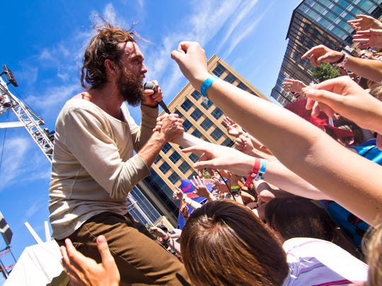 Lead Vocals Alex Ebert of Edward Sharpe and the Magnetic Zeros moves from the stage into the crowd.