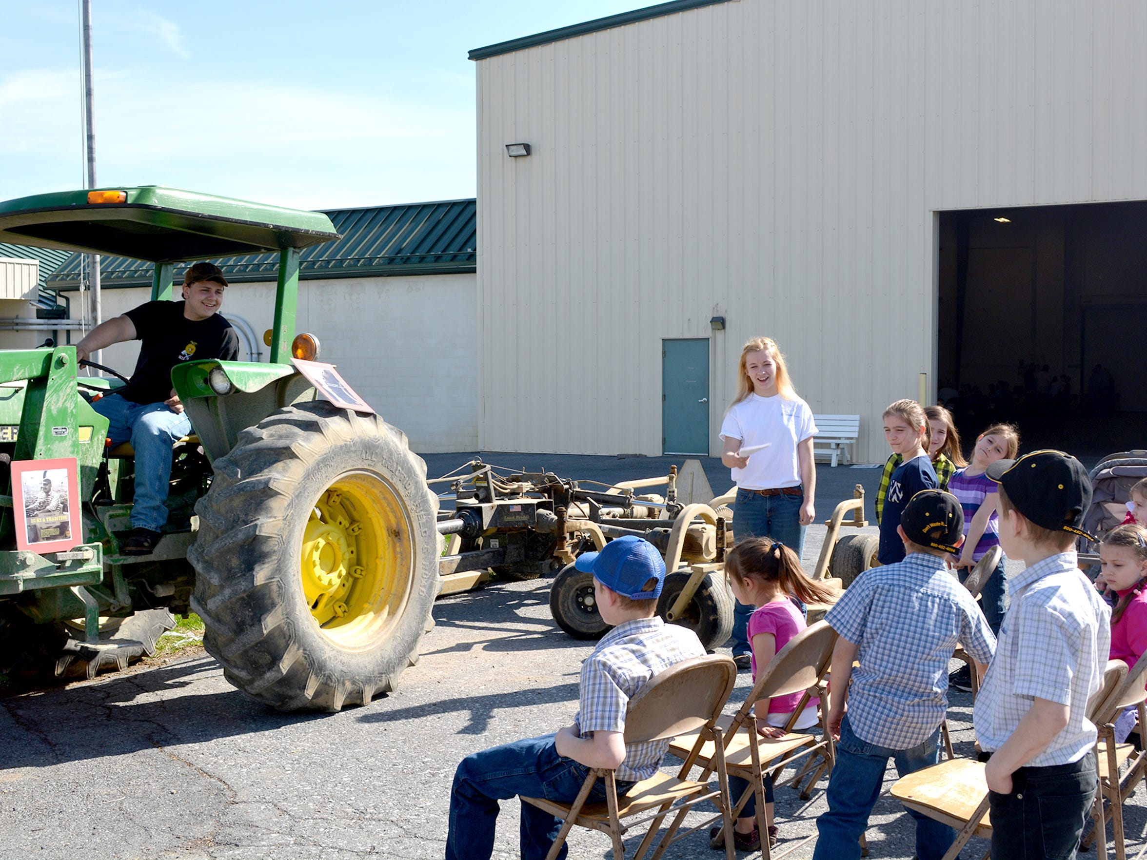 Attendees at Lebanon County Farm and Home Safety Day on April 9, 2015 learn how difficult it is to see people behind you while seated on a tractor.