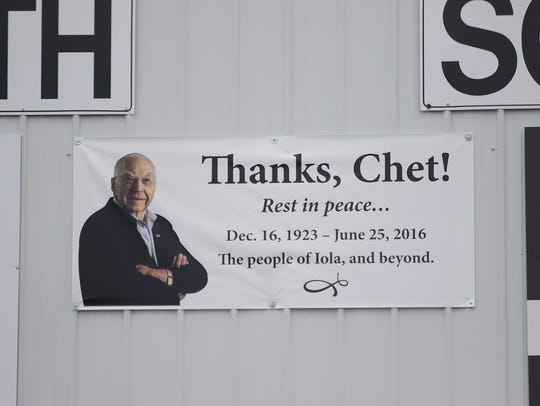 A banner for Chet Krause, who founded the Iola Old