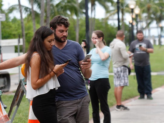 Hundreds joined in the Pokemon Go craze July 14 at Centennial Park in Fort Myers.