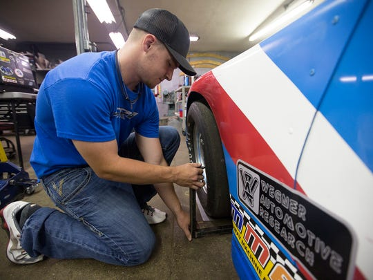 Colin Reffner measures his front wheel tire in his