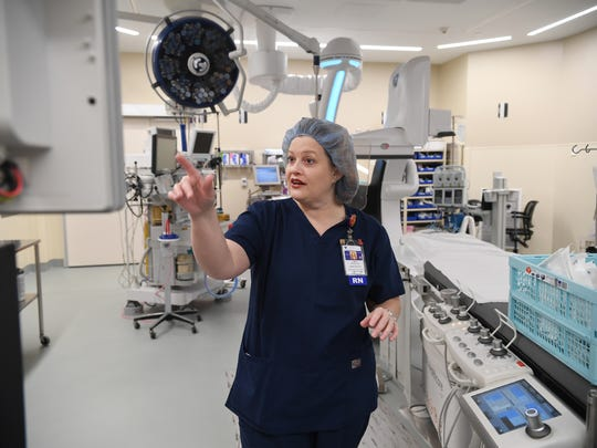 Kelli Brooks, administrative director of surgical services at Bon Secours St. Francis hospital, explains some of the technology available in the new hybrid operating room.
