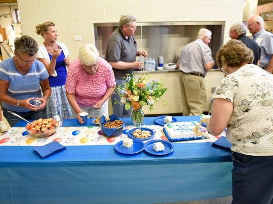 A group gathers for a luncheoon Monday with Ed LeMieux, who is retiring from the Meals On Wheels program, at First Lutheran Church, Chambersburg.