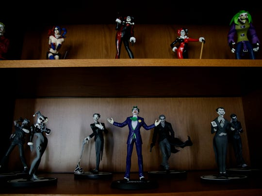 Collectable figurines sit on shelves inside the office