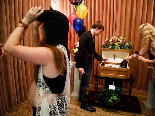 "Jennifer Leonhard, left, and her husband Bobby, right, spend a few last moments at the casket of their son William after his funeral on Saturday, July 16, 2016 in Des Moines. ""Every moment we had was a blessing,"" Bobby said of their short time with William."