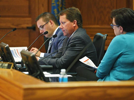 Sioux Falls City Council Members, from left, Greg Neitzert, Marshall Selberg and Michelle Erpenbach look on as Sioux Falls Mayor Mike Huether delivers his 2017 Budget Address Tuesday, July 26, 2016, at Carnegie Town Hall in downtown Sioux Falls.