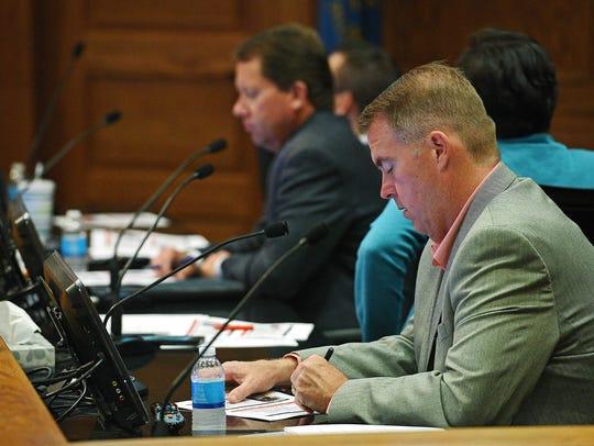 Sioux Falls City Council Member Pat Starr follows along